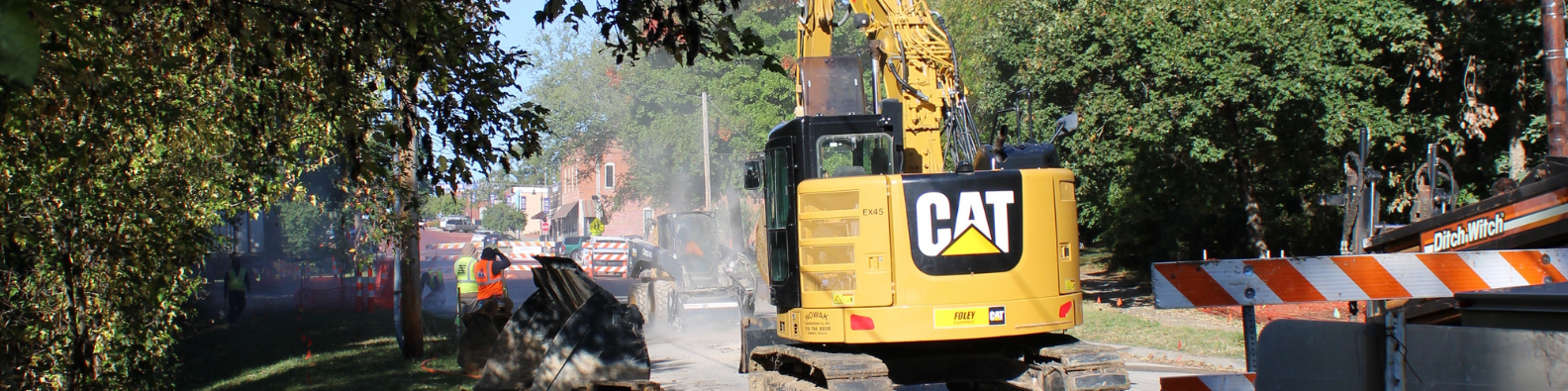 large equipment works on a sewer project on High Street